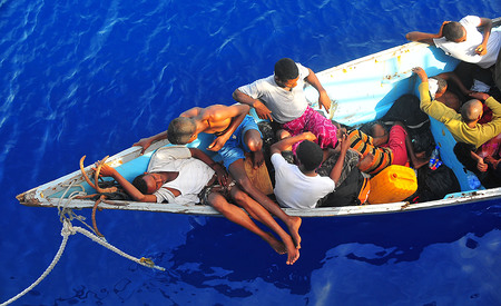 090525-N-4774B-032 GULF OF ADEN (May 24, 2009) Somali migrants in a disabled skiff wait for assistance from Sailors aboard the guided-missile cruiser USS Lake Champlain (CG 57). The skiff, originally ferrying 52 passengers, was spotted in distress b