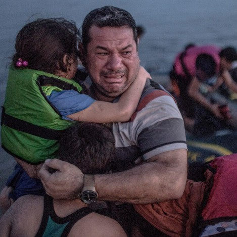 Syrian refugee breaks out in tears of joy, arriving on the island of Kos in Greece on 15 August by DanielEtter