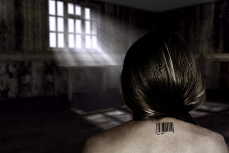 The concept of trafficking in people with a naked female back and barcode