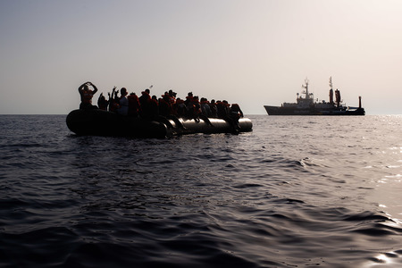 At the first light on August 23, the Sea-Watch 4 morning look out spotted a small black vessel in international waters, some 31 nautical miles from the coast of Libya. The overcrowded and unseaworthy rubber boat carried 60 men and women, as well as 9